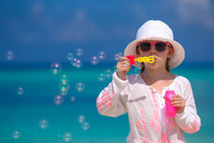 Adorable little girl making soap bubbles during Stock Image