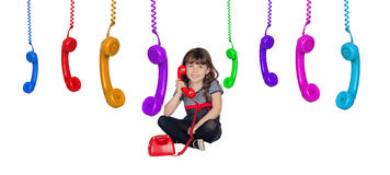 Adorable little girl with many telephones Royalty Free Stock Images