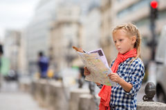 Adorable little girl with map of european city Stock Photography