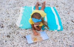 Adorable little girl with map find the way on Royalty Free Stock Photography