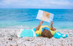 Adorable little girl with map find the way on Stock Photography