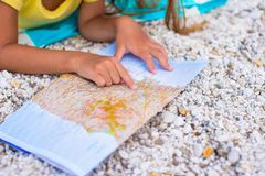 Adorable little girl with map find the way on Stock Images