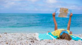 Adorable little girl with map find the way on Stock Photo