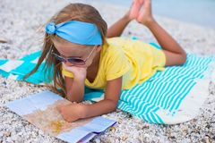 Adorable little girl with map of island on Stock Photo