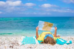 Adorable little girl with map of island on Royalty Free Stock Photo