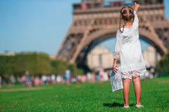 Adorable little girl with map of Paris background the Eiffel tower Royalty Free Stock Photos