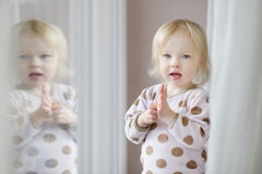 Adorable little girl with milk moustache Royalty Free Stock Photos