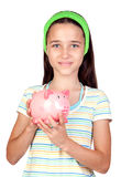 Adorable little girl with money-box Stock Photography