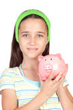 Adorable little girl with money-box Stock Image