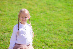 Adorable little girl near the Eiffel tower during Royalty Free Stock Image