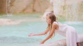 Adorable little girl near the Fountain of Trevi in Rome. Happy kid enjoy their european vacation in Italy stock video footage