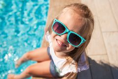Adorable little girl near pool during tropical Royalty Free Stock Photos