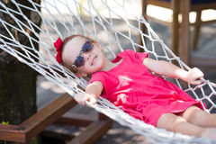 Free Adorable Little Girl On Tropical Vacation Relaxing Stock Photography - 53404292