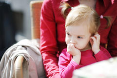 Adorable little girl at outdoor cafe Royalty Free Stock Image