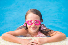 Adorable little girl in outdoor swimming pool Stock Images