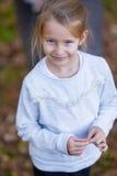 Adorable little girl outdoors at beautiful autumn Stock Photos