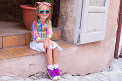 Adorable little girl in outdoors cafe in European city Royalty Free Stock Images