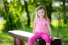 Adorable little girl outdoors Stock Photos
