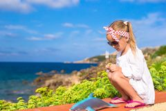 Adorable little girl outdoors during summer Stock Image