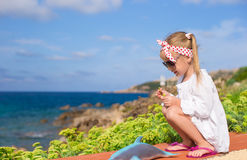 Adorable little girl outdoors during summer Stock Photography