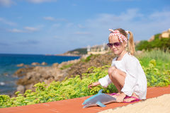 Adorable little girl outdoors during summer Stock Images