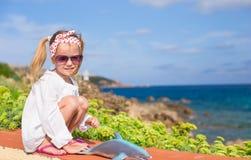 Adorable little girl outdoors during summer Stock Photos