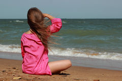 Adorable little girl over the sea Stock Image