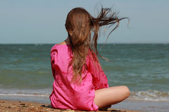 Adorable little girl over the sea Royalty Free Stock Image