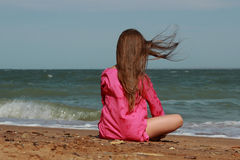 Adorable little girl over the sea Stock Photography