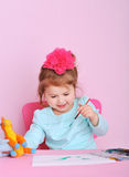 Adorable little girl painting at home Royalty Free Stock Photography