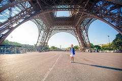 Adorable little girl in Paris under the Eiffel tower Stock Images