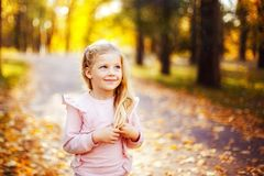 Adorable little girl in park royalty free stock image
