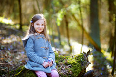 Adorable little girl picking the first flowers of spring in the woods Royalty Free Stock Photography