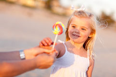 Adorable Little Girl Picking out Lollipop Royalty Free Stock Photos