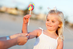 Adorable Little Girl Picking out Lollipop Outside Stock Image