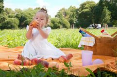 Adorable little girl on picnic in the beauty park Royalty Free Stock Photo