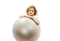 Adorable little girl with pilates ball Royalty Free Stock Photos