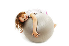 Adorable little girl with pilates ball Royalty Free Stock Image
