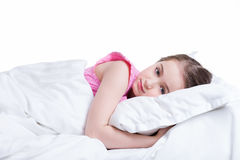 Adorable little girl in pink nightie awake. Royalty Free Stock Photos