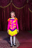 Adorable little girl in a pink and yellow costume Royalty Free Stock Photography