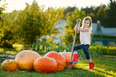 Adorable little girl with a pitchfork Royalty Free Stock Image