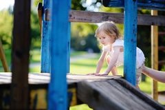 Adorable little girl on a playground Stock Photography