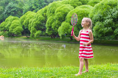 Adorable little girl playing badminton on picnic Stock Images