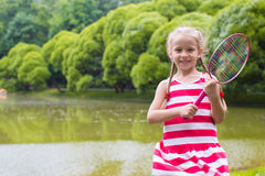 Adorable little girl playing badminton on picnic Royalty Free Stock Image