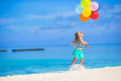 Adorable little girl playing with balloons at the Stock Photography