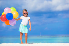Adorable little girl playing with balloons at the Royalty Free Stock Photo
