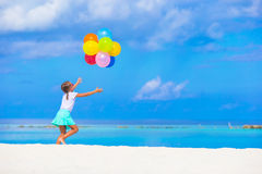 Adorable little girl playing with balloons at the Royalty Free Stock Images