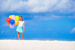Adorable little girl playing with balloons at the Stock Photo