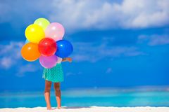 Adorable little girl playing with balloons at the Royalty Free Stock Photos