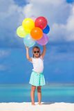 Adorable little girl playing with balloons at the Stock Images